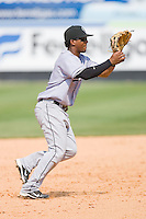 Shortstop Osvaldo Martinez #2 of the Jacksonville Suns fields a ground ball against the Carolina Mudcats at Five County Stadium May 16, 2010, in Zebulon, North Carolina.  Photo by Brian Westerholt /  Seam Images
