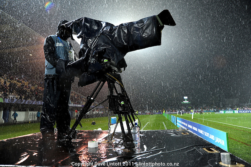 A Skysports cameraman shoots the teams warming up in the rain before the France v Canada pool A match of the 2011 IRB Rugby World Cup at McLean Park, Napier, New Zealand on Sunday, 18 September 2011. Photo: Dave Lintott / lintottphoto.co.nz