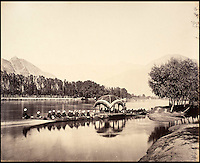 BNPS.co.uk (01202 558833)<br /> Pic: DominicWinter/BNPS<br /> <br /> The Commissioner&rsquo;s boat at Srinagar in Kashmir.<br /> <br /> Fascinating 150 year-old photographs of India taken in the aftermath of the failed mutiny have sold for almost &pound;8,000 at auction.<br /> <br /> The images, which date from 1863 to 1870, capture native soldiers with their weapons and picturesque landscapes and were taken by celebrated 19th century photographer Samuel Bourne.<br /> <br /> They went for a hammer price of &pound;6,400 to a private collector from America who bid online with extra fees pushing the overall price above &pound;7,800.<br /> <br /> Together with Charles Shepherd, Bourne set up photo studio Bourne &amp; Shepherd first in Simla in 1863 and later in Calcutta.