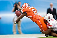 January 1, 2009:    Clemson safety DeAndre McDaniel (2) dives for a touchdown after recovering a fumble by Nebraska running back Quentin Castille (19) during  first half game action in the 64th annual Konica Minolta Gator Bowl between the Nebraska Cornhuskers  and the Clemson Tigers  at Jacksonville Municipal Stadium in Jacksonville, Florida.