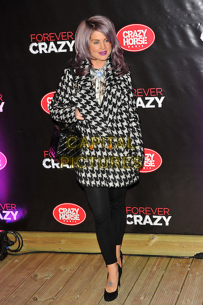 Kelly Osbourne.Forever Crazy by Crazy Horse VIP Gala Night at South Bank, London, England..September 19th 2012.full length black white houndstooth dogtooth pattern leggings hand in pocket dyed purple hair .CAP/CJ.©Chris Joseph/Capital Pictures.