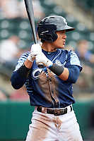 Columbus Clippers shortstop Yu Chang (6) warms up on deck during a game against the Gwinnett Stripers on May 17, 2018 at Huntington Park in Columbus, Ohio.  Gwinnett defeated Columbus 6-0.  (Mike Janes/Four Seam Images)