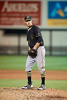 Bradenton Marauders starting pitcher James Marvel (12) gets ready to deliver a pitch during the second game of a doubleheader against the Lakeland Flying Tigers on April 11, 2018 at Publix Field at Joker Marchant Stadium in Lakeland, Florida.  Bradenton defeated Lakeland 1-0.  (Mike Janes/Four Seam Images)