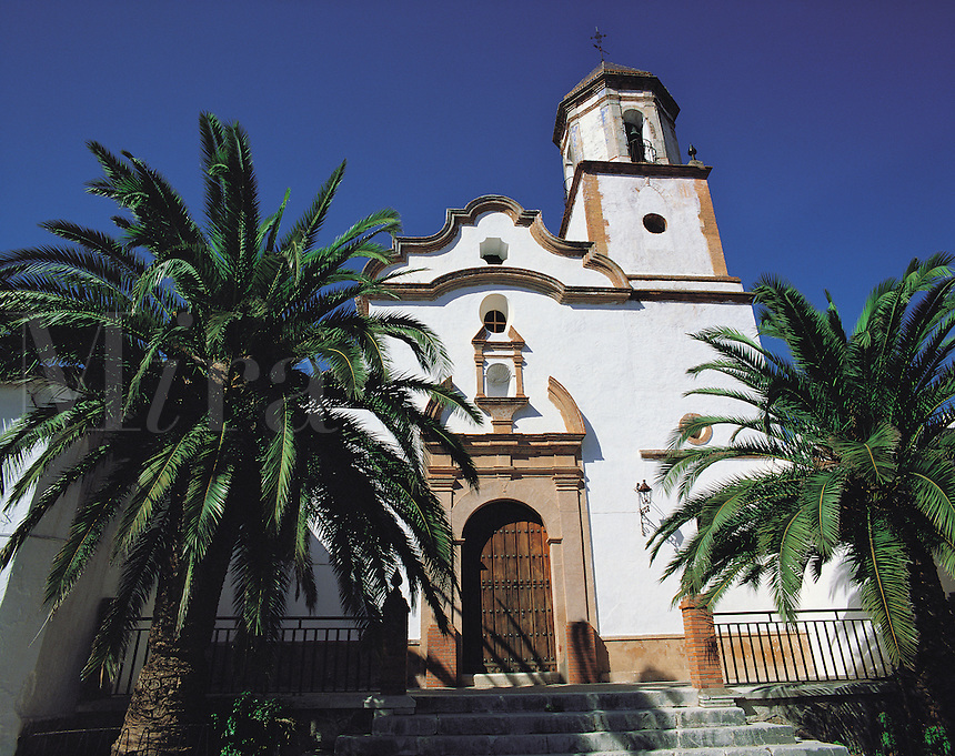 Church flanked by palm-trees in the village of Villamartin, southern Spai
