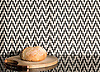 Ziggurat Petite, a hand-cut tumbled mosaic, shown in Nero Marquina and Calacatta, is part of the Tissé® collection for New Ravenna.