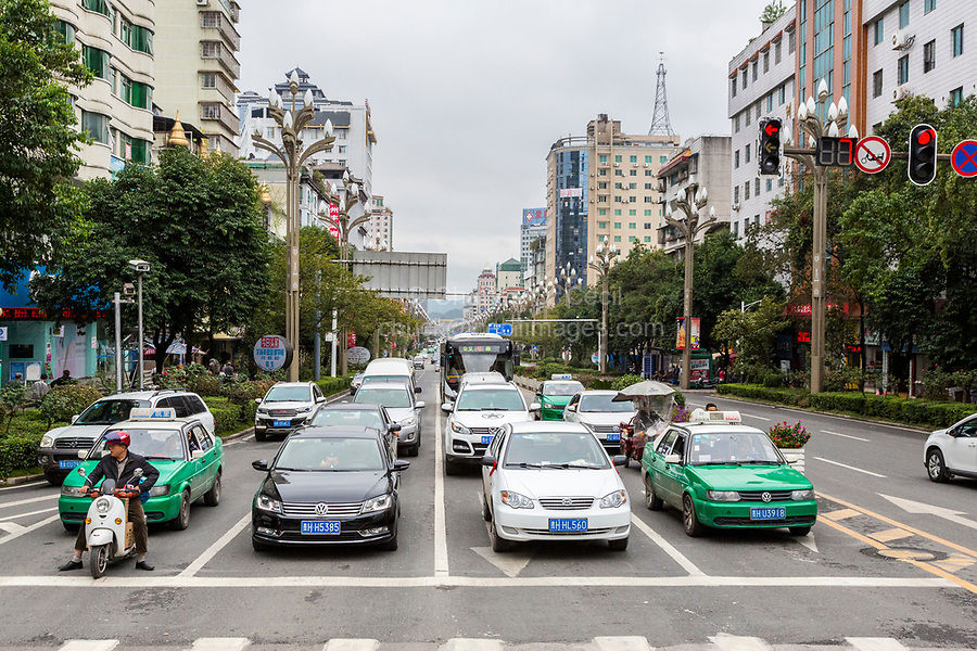 Kaili, Guizhou, China.  Mid-day Traffic in Downtown Kaili.