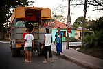 Teens from Pinar del Rio board a public transport truck, in Vinales, Cuba, on Sunday, April 21, 2008..
