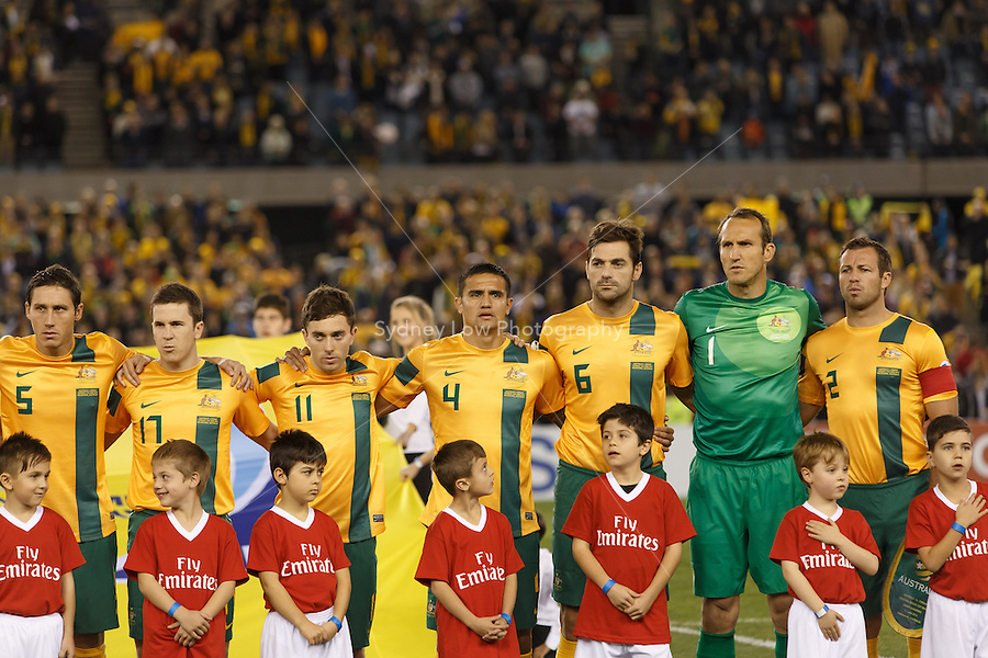 MELBOURNE, 11 JUNE 2013 - The Australian team listen to the national anthem prior to their Round 4 FIFA 2014 World Cup qualifier match between Australia and Jordan at Etihad Stadium, Melbourne, Australia. Photo Sydney Low for Zumapress Inc. Please visit zumapress.com for editorial licensing. *This image is NOT FOR SALE via this web site.