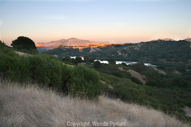 Mount Diablo glows at sunset as viewed from a Lafayette Reservoir Trail.