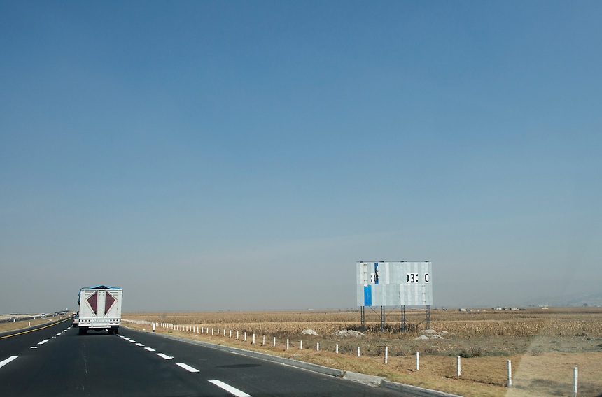 Drive-by billboards in the outskirts of Toluca, Estado de Mexico, Mexico.