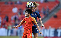 Cleveland, Ohio - Tuesday June 12, 2018: Tierna Davidson, Wang Shanshan during an international friendly match between the women's national teams of the United States (USA) and China PR (CHN) at FirstEnergy Stadium.
