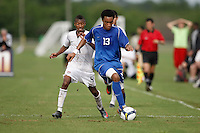 Brian Span (13) of the Academy Select Team is defended by Jordan McCrary (4) of the USA. The US U-17 Men's National Team defeated the Development Academy Select Team 3-1 during day one of the US Soccer Development Academy  Spring Showcase in Sarasota, FL, on May 22, 2009.