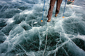 The ice on Lake Baikal in Siberia, Russia. .Five people: Justin Jin (Chinese-British), Heleen van Geest (Dutch), Nastya and Misha Martynov (Russian) and their Russian guide Arkady pulled their sledges 80 km across the world's deepest lake, taking a break on Olkhon Island. They slept two nights on the ice in -15c. .Baikal, the world's largest lake by volume, contains one-fifth of the earth's fresh water and plunges to a depth of 1,637 metres..The lake is frozen from November to April, allowing people to cross by cars and lorries.