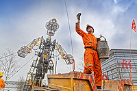 Pictured: The Man Engine at the Waterfront Museum in Swansea, Wales, UK. Thursday 12 April 2018<br /> Re: The largest mechanical puppet in Britain starts its tour across south Wales.<br /> Man Engine, a mechanical miner which measures 36ft (11m) tall, will appear at the Waterfront Museum in Swansea, Wales, animated by a dozen handlers.<br /> The giant is visiting areas linked to the nation's industrial past.