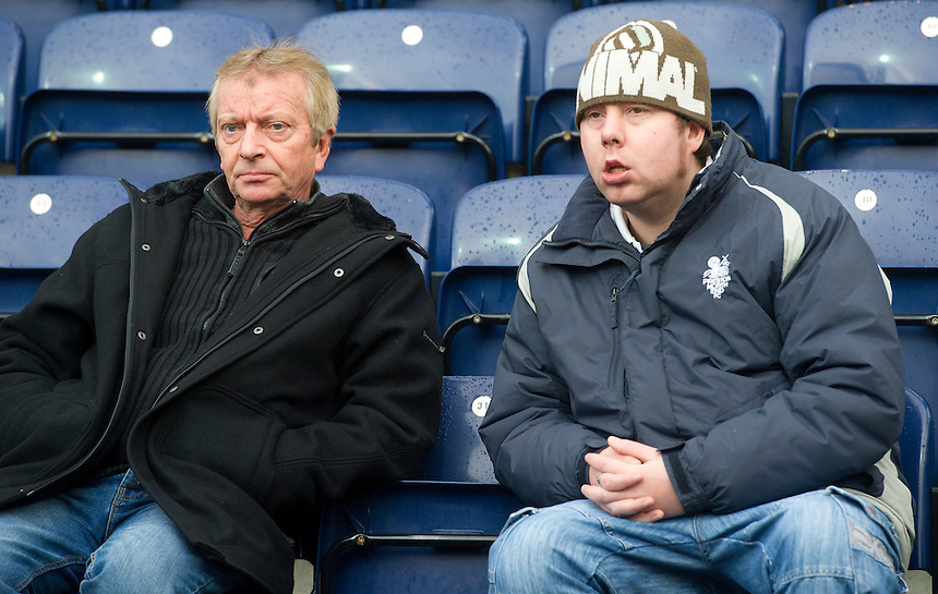 Preston North End fans wait for the kick off<br /> <br /> Photographer Stephen White/CameraSport<br /> <br /> Football - The Football League Sky Bet League One - Preston North End v Milton Keynes Dons - Saturday 13th December 2014 - Deepdale - Preston<br /> <br /> &copy; CameraSport - 43 Linden Ave. Countesthorpe. Leicester. England. LE8 5PG - Tel: +44 (0) 116 277 4147 - admin@camerasport.com - www.camerasport.com