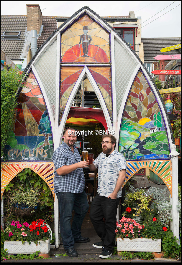 BNPS.co.uk (01202 558833)<br /> Pic: TomWren/BNPS<br /> <br /> Geoff Popple (right) and Carl Filer pub managers for Chaplins & The Cellar Bar.<br /> <br /> A beer garden likened to 'the set of a David Lynch film' has been named the best in the country. <br /> <br /> Chaplin's Cellar Bar's backyard lay empty and practically unused until it was bought by Harry Seccombe, formerly the owner of a local builders' merchants, a decade ago.<br /> <br /> But now punters can sip their drinks surrounded in a three-level haven of exotic plants, druid style murals and even a suit of armour following a radical transformation. <br /> <br /> And in recognition of this innovation the pub, located in a busy suburb of Bournemouth in Dorset, has been awarded the title of having 'Britain's Best Beer Garden 2016'.