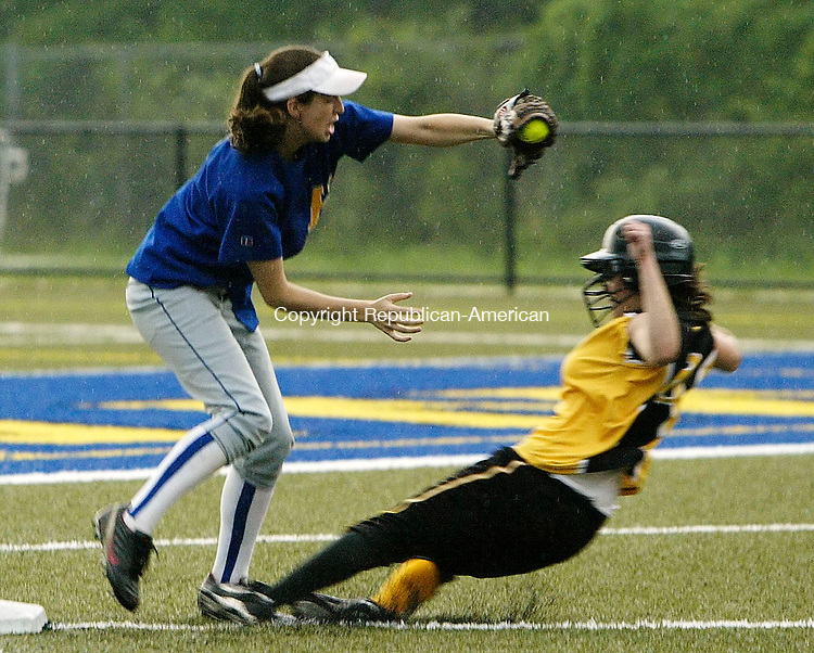WATERBURY, CT 05/27/08- 052708BZ09-  Kaynor Tech's Alyssa Nealy (8) slides under the tag of Housatonic's Jackie Underwood (8) during their game at Municipal Stadium Tuesday.  <br />  Jamison C. Bazinet Republican-American