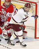 Lillian Ribeirinha-Braga (BU - 15), Emily Field (BC - 15) -  The Boston College Eagles defeated the visiting Boston University Terriers 5-0 on BC's senior night on Thursday, February 19, 2015, at Kelley Rink in Conte Forum in Chestnut Hill, Massachusetts.