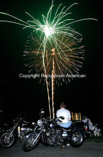 TORRINGTON, CT 04 JULY 2006 070406BZ04- Shawn Howard, of  Torrington, sits stop his Yamaha V-Star Classic motorcycle while watching the fireworks display at Torrington Middle School Tuesday night.<br /> Jamison C. Bazinet Republican-American