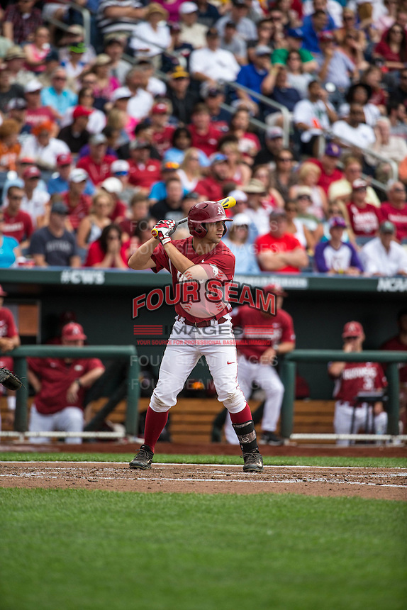 Tyler Spoon (8) of the Arkansas Razorbacks bats during a game between the Virginia Cavaliers and Arkansas Razorbacks at TD Ameritrade Park on June 13, 2015 in Omaha, Nebraska. (Brace Hemmelgarn/Four Seam Images)