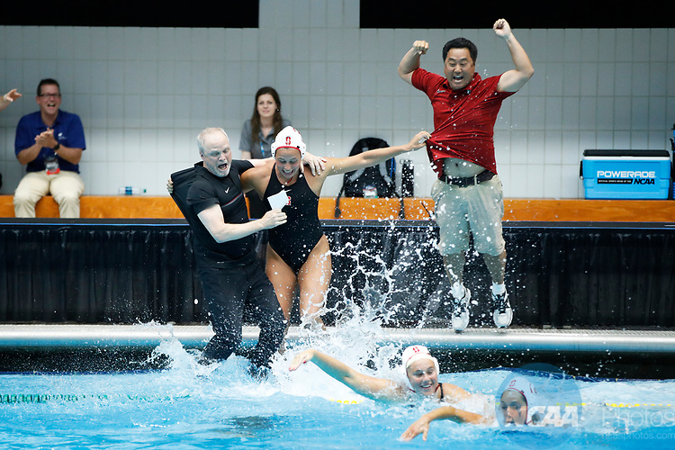 INDIANAPOLIS, IN - MAY 14: Stanford University coaches John Tanner (left) and Kyle Utsumi go into the pool with their players after winning the Division I Women's Water Polo Championship against UCLA held at the IU Natatorium-IUPUI Campus on May 14, 2017 in Indianapolis, Indiana. (Photo by Joe Robbins/NCAA Photos/NCAA Photos via Getty Images)