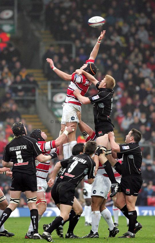 Photo. Frances Leader..Sarecens v Gloucester. Zurich Premiership. .21/11/2004..Gloucester's James Forrester jumps for the ball with Saracens' Hugh Vyvyan. .