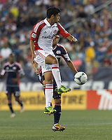Toronto FC midfielder Matias Laba (20) attempts to control the ball. In a Major League Soccer (MLS) match, Toronto FC (white/red) defeated the New England Revolution (blue), 1-0, at Gillette Stadium on August 4, 2013.