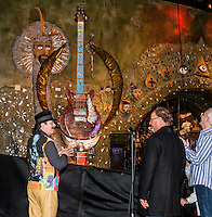 LAS VEGAS, NV - January 16 : Carlos Santana, Dale Evers and Paul Reed Smith  pictured as House of Blues Las Vegas unveils 13-foot high guitar sculpture ?Wings of Legend? that will commemorate the return of Carlos Santana's residency: An Intimate Evening with Santana: Greatest Hits Live - Yesterday, Today & Tomorrow and continue the 20th Anniversary celebration of the House of Blues brand at House of Blues at Mandalay Bay in Las Vegas, Nevada on January 16, 2013. Credit: Kabik/Starlitepics/MediaPunch Inc. ***HOUSE COVERAGE*** /NortePhoto