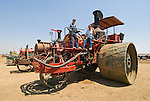 Annual ACMOC Caterpillar Tractor show at the Best Ranch near Woodland, CA..line up of four Best Steam-Powered tractors from the early 1900s..Best No. 175 tractor crew