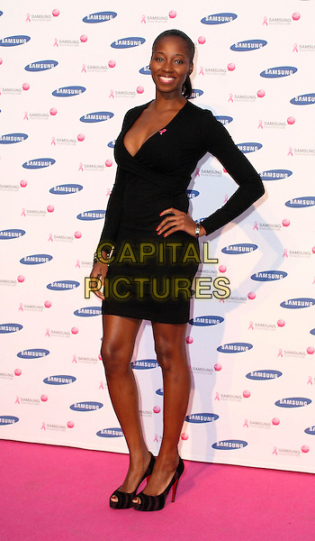 JAMELIA aka Jamelia Niela Davis.Attending the Samsung Pink Ribbon Breast Awareness Day at Westfield Shopping Centre, London, England, UK, .October 15th 2009.full length black dress hand on hip peep toe shoes tiger print animal brown christian louboutin heels low cut .CAP/JIL.©Jill Mayhew/Capital Pictures