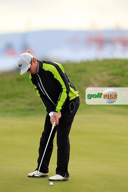 Lauri Ruuska (FIN) putts on the 13th green during Saturday's Round 2 of the 2013 Irish Amateur Open Championship at The Royal Dublin Golf Club, 11th May 2013..Picture: Eoin Clarke www.golffile.ie.