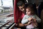 Nowras Al Aydi, 19, holds his little sister Dalaa, 3, on a train, while moving across Germany to their new house in Lüneburg, Oct. 26, 2014. Nesrine Al Aydi and her five children set off from the group home for refugees in Lahr for Lüneburg and their new home, a 12-hour journey involving seven separate trains. Nesrine's husband Wisam has been working on the apartment in Lüneburg and will await their arrival there. Wisam Al Aydi and his family fled their home in besieged Yarmouk Palestinian refugee camp near Damascus after it was hit by shelling last year. Since then, the family of seven has moved 11 times, including at least five times in Germany. They were preparing for a final move, to the city of Lüneberg near Hamburg, to be closer to Wisam's brother Mwafak. Around 200,000 people are expected to apply for asylum in Germany in 2014, with an ever-increasing number coming from Syria.