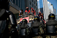 """Red Shirt"" protesters are met by soldiers in riot gear in Ploenchit, one of Bangkok's busy business areas in the city centre."