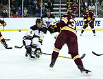 SIOUX FALLS, SD - MARCH 23: Clint Lewis #4 from Mankato books a shot attempt of Parker Mackay #39 from Minnesota Duluth during their game at the 2018 West Region Men's NCAA DI Hockey Tournament at the Denny Sanford Premier Center in Sioux Falls, SD. (Photo by Dave Eggen/Inertia)