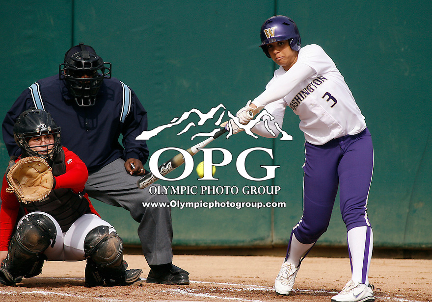 14 March 2010:  Washington Huskies #3 Niki Williams connects for a two run home run against Seattle University. Washington defeated Seattle University 8-3 at Husky Softball Stadium in Seattle, WA.