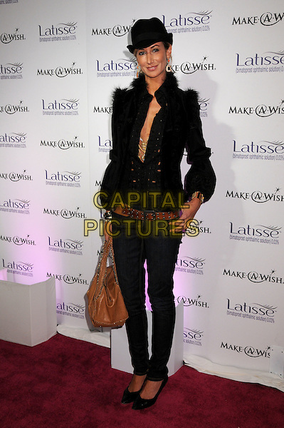 LADY VICTORIA HERVEY.Launch Party for LATISSE held at a private gallery, Los Angeles, California, USA..March 26th, 2009.full length skinny jeans denim black jacket hat fur trim brown bag purse .CAP/ADM/BP.©Byron Purvis/AdMedia/Capital Pictures.