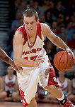 MADISON, WI - NOVEMBER 3: Guard Jason Bohannon #12 of the Wisconsin Badgers handles the ball against the University of Wisconsin-Stout Blue Devils at the Kohl Center on September 3, 2006 in Madison, Wisconsin. The Badgers beat the Blue Devils 82-33. Photo by David Stluka