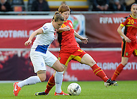 20140507 - LEUVEN , BELGIUM : duel pictured with Dutch Sherida Spitse (l) and Belgian Lien Mermans (r) during the female soccer match between Belgium and The Netherlands, on the eighth matchday in group 5 of the UEFA qualifying round to the FIFA Women World Cup in Canada 2015 at Stadion Den Dreef , Leuven . Wednesday 7th May 2014 .  PHOTO DAVID CATRY