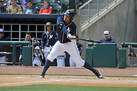 Northwest Arkansas Naturals first baseman Samir Duenez (9) swings during a game against the Frisco RoughRiders at Arvest Ballpark on May 24, 2017 in Springdale, Arkansas.  The RoughRiders defeated the Naturals 7-6 in the completion of the game suspended on May 23, 2017.  (Dennis Hubbard/Four Seam Images)