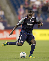 New England Revolution midfielder Shalrie Joseph (21) passes the ball. In a Major League Soccer (MLS) match, the New England Revolution tied Toronto FC, 0-0, at Gillette Stadium on June 15, 2011.