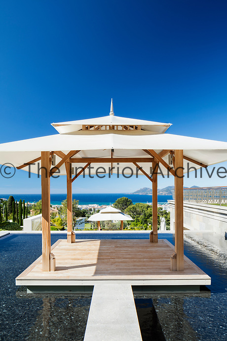 A pool gazebo gives a view of the Bay of Cannes beyond.