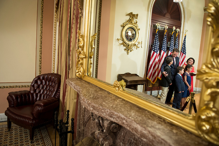 UNITED STATES – July 10: Rep.-elect Michael Cloud, R-Texas, waits with his family before House Speaker Paul Ryan, R-Wis., swears him in at the Capitol on Tuesday, July 10, 2018.  (Photo By Sarah Silbiger/CQ Roll Call)
