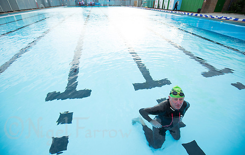 28 SEP 2013 - LONDON, GBR - Rod Elder recovers after finishing the 7.3 mile swim of the Enduroman 2013 Lands End to London to Dover ultra triathlon at Charlton Lido in London, Great Britain (PHOTO COPYRIGHT © 2013 NIGEL FARROW, ALL RIGHTS RESERVED)