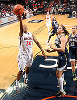 Virginia guard Faith Randolph (20) shoots the ball next to Notre Dame forward Natalie Achonwa (11) during the first half of an NCAA basketball game Sunday Jan. 12, 2014 in Charlottesville, VA. Notre Dame defeated Virginia  79-72. (Photo/The Daily Progress/Andrew Shurtleff)