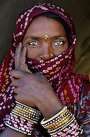 Woman in scraf at Pushkar camel fair, rajasthan, India, 2011
