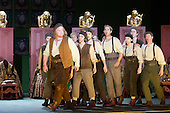 """London, UK. 30 January 2015. Nicky Spence as David (left) leading the Apprentices. Richard Wagner's opera """"The Mastersingers of Nuremberg"""" (Die Meistersinger von Nuernberg) is performed live on stage during the dress rehearsal with English National Opera Music Director Edward Gardner leading the ENO Orchestra and Chorus. Directed by Richard Jones with with leads played by Gwyn Hughes Jones as Walter von Stolzing, Rachel Nicholls as Eva Pogner, Madeleine Shaw as Magdalene, Nicky Spence as David (Hans Sachs' apprentice), Iain Paterson as Hans Sachs, Andrew Shore as Sixtus Beckmesser and James Creswell as Veit Pogner. The opera will run for 8 performances at the London Coliseum from 7 February 2015. Photo: Bettina Strenske"""