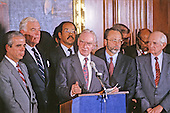 In this file photo dated April 13, 1989, the Speaker of the United States House of Representatives Jim Wright (Democrat of Texas) holds a press conference with U.S. House Democratic Leaders to address the ethics charges against him in Washington, D.C.  Standing with the Speaker, from left to right: U.S. Representative Tony Coehlo (Democrat of California), U.S. Representative Tom Foley (Democrat of Washington), U.S. Representative William H. Gray III (Democrat of Pennsylvania), Speaker Wright, U.S. Representative David E. Bonior (Democrat of Michigan), and U.S. Representative Jack Brooks (Democrat of Texas).  Wright passed away at age 92 on May 6, 2015.<br /> Credit: Arnie Sachs / CNP