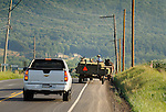 Nippenose Valley, PA. Route 654 with Amish wagon and traffic.