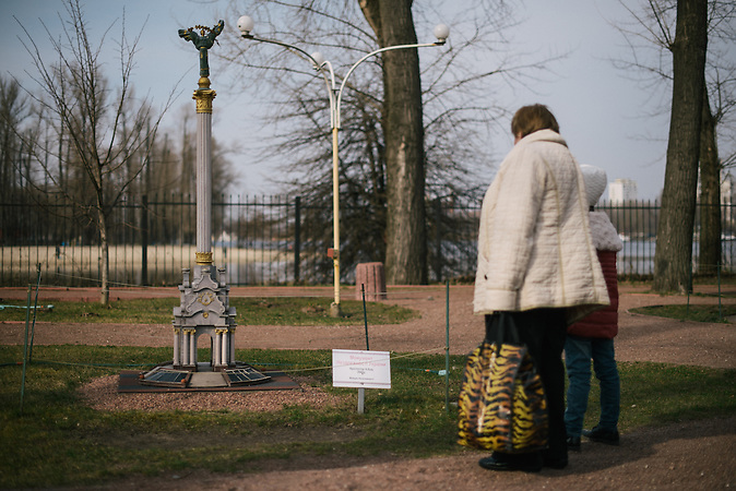 Visitors observing a miniature of Maidan in Mini Kiev. Kiev.