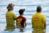 "Crew members for John Grigg, GP-52 ""Wanna Bee"" watch their boat race.  (Grand Prix Hydroplane(s)"